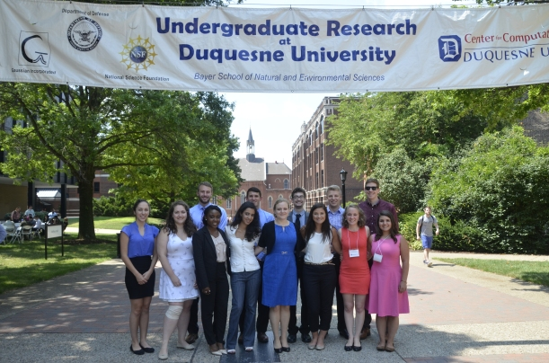 group of undergraduate research students Duquesne University outside on academic walk